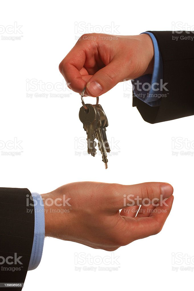 Key to the happiness - Hands holding keys royalty-free stock photo
