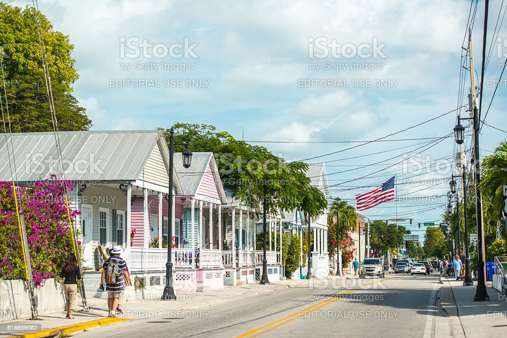 Key West street with giant American Flag, Florida, USA stock photo