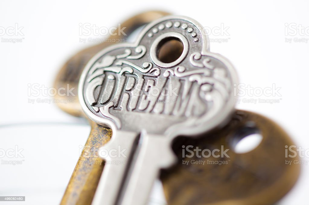 Key with DREAMS engraved on it. stock photo