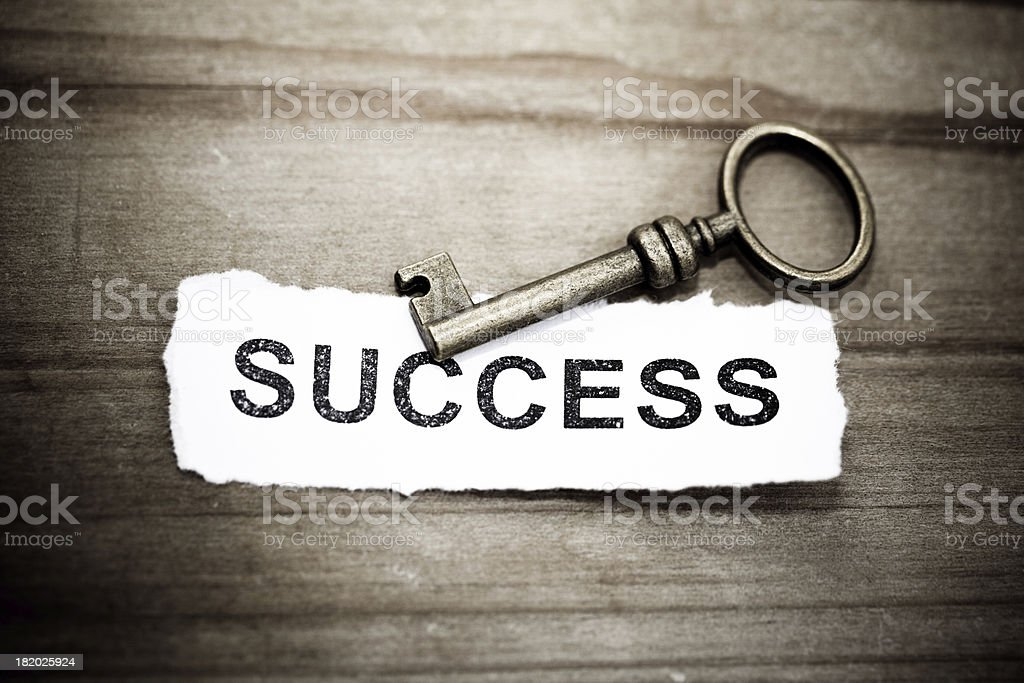 Key with success written on paper stock photo