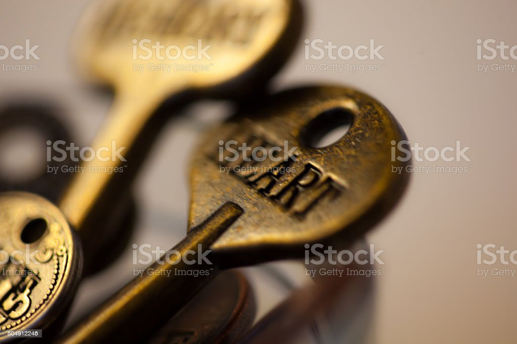 Key with the word HEART engraved on it. stock photo