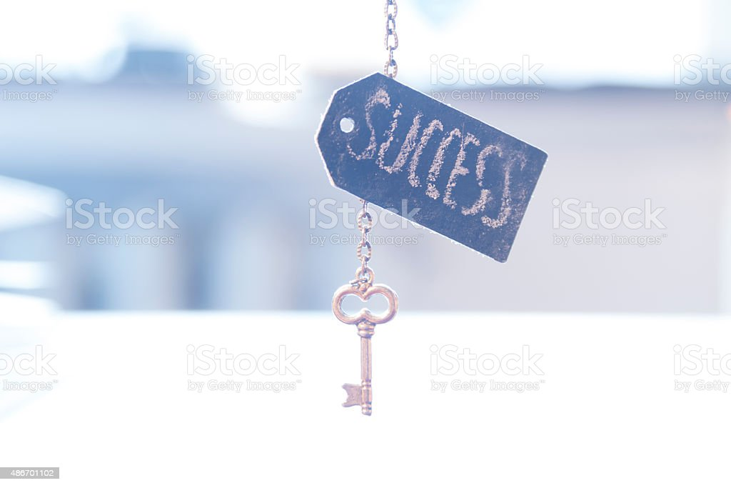 key with word 'success' stock photo