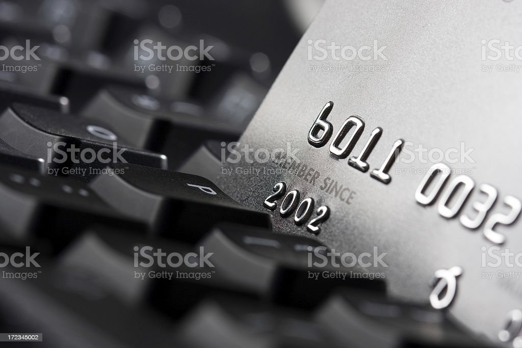 A keyboard and a credit card representing finances royalty-free stock photo