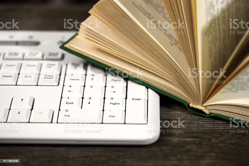 Keyboard and book stock photo
