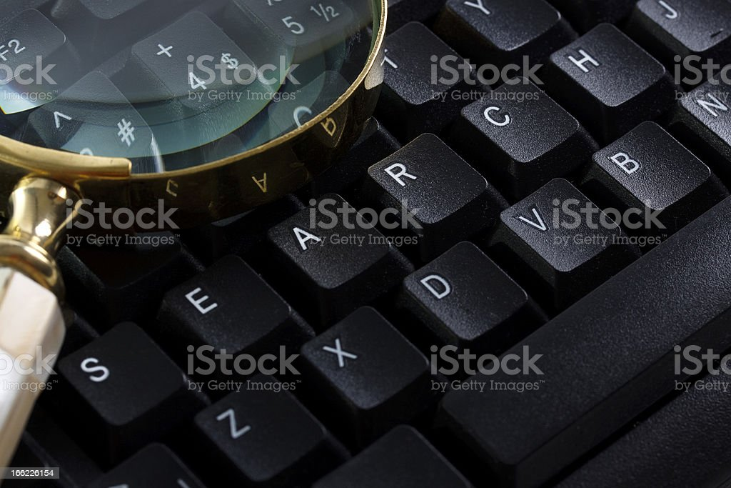 Keyboard and Magnifier royalty-free stock photo