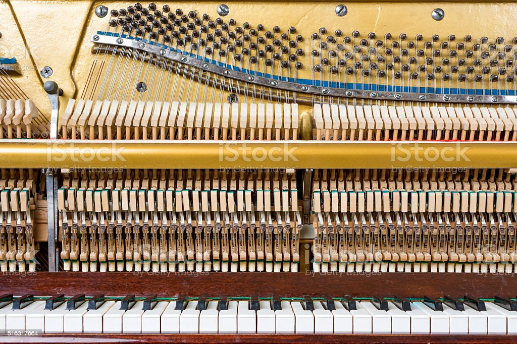 Keyboard and mechanics of an upright piano stock photo