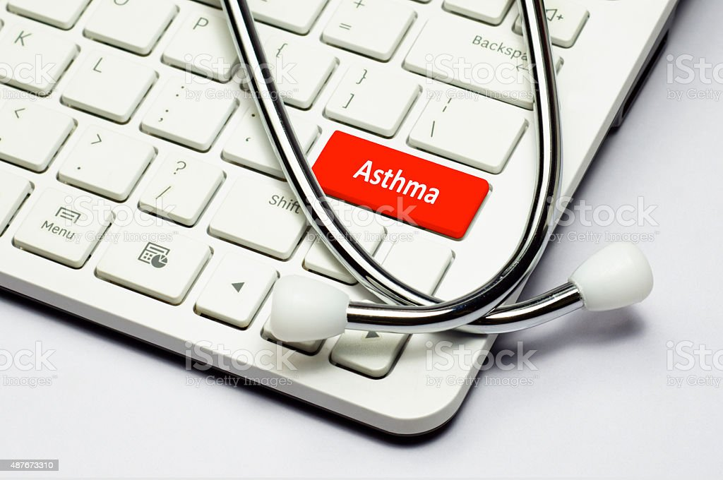 Keyboard, Asthma text and Stethoscope stock photo