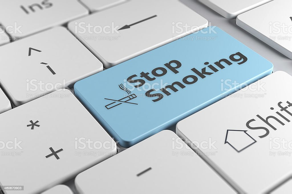 keyboard close up view with blue button stop smoking stock photo