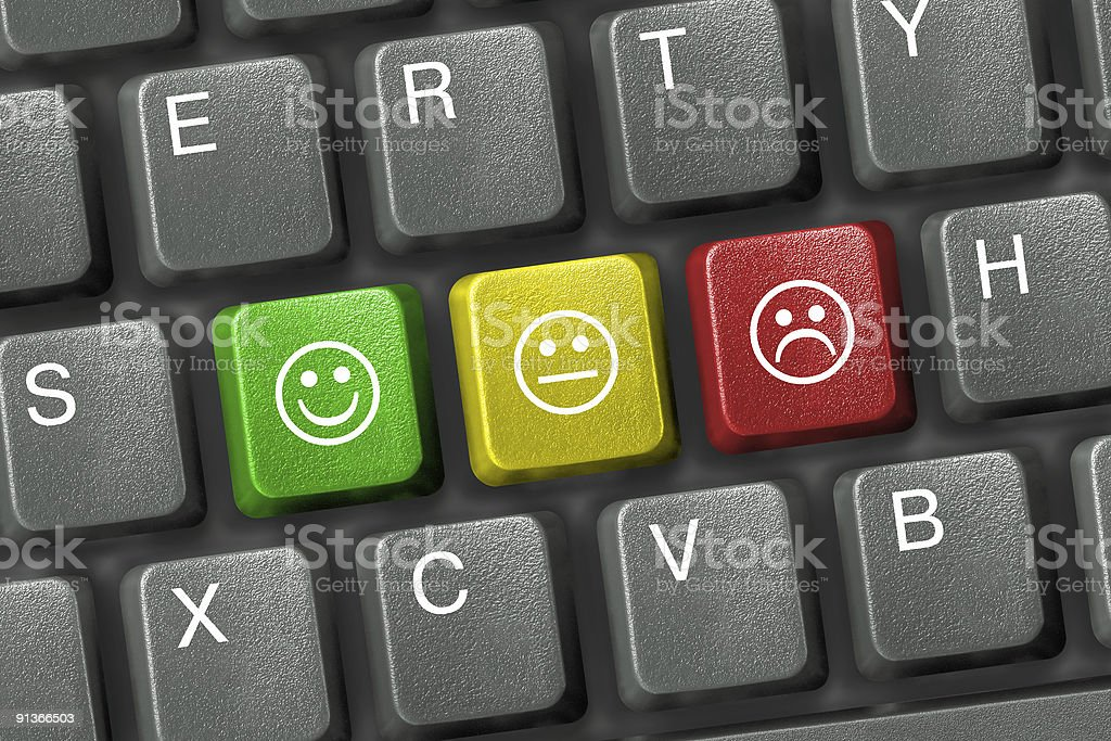 Keyboard close-up with three smiley keys stock photo