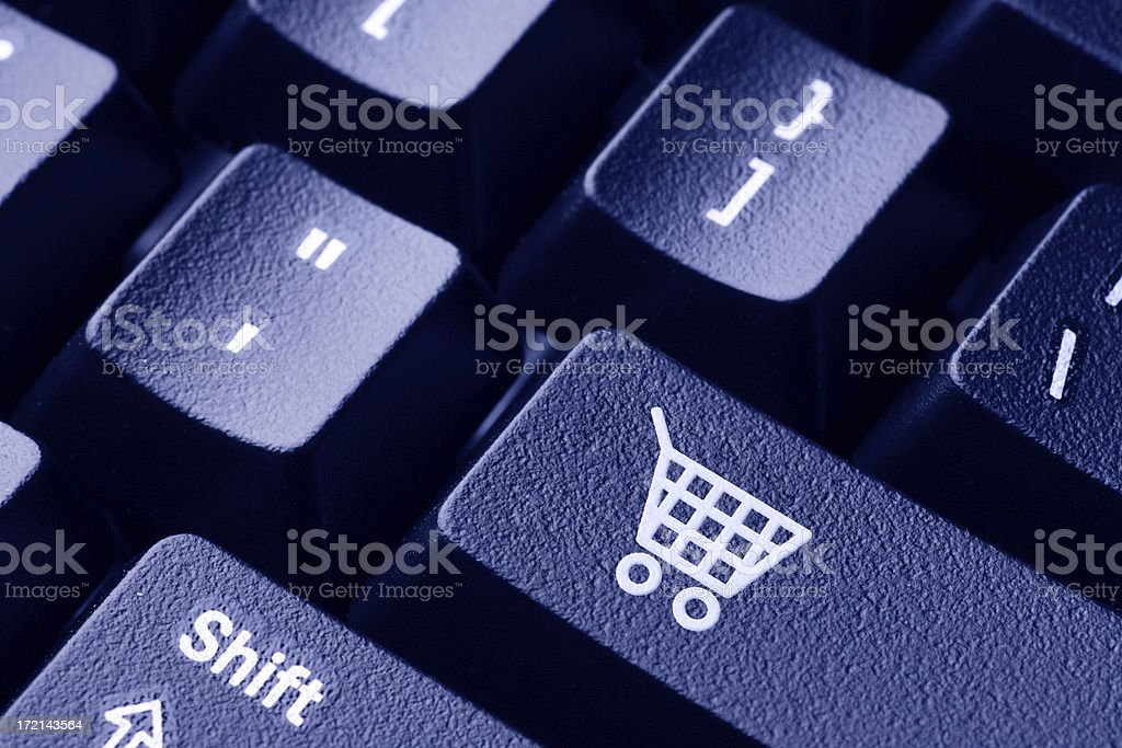A keyboard featuring an online shopping key royalty-free stock photo