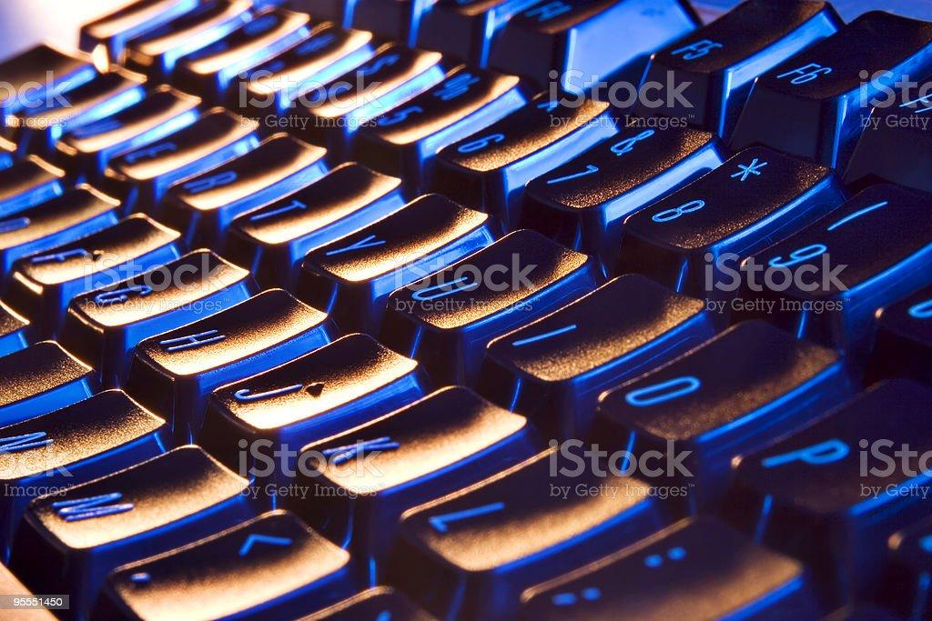 Keyboard illumination with blue light from inside stock photo