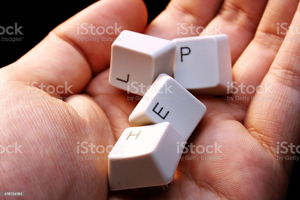 HELP - keyboard in a hand ! stock photo