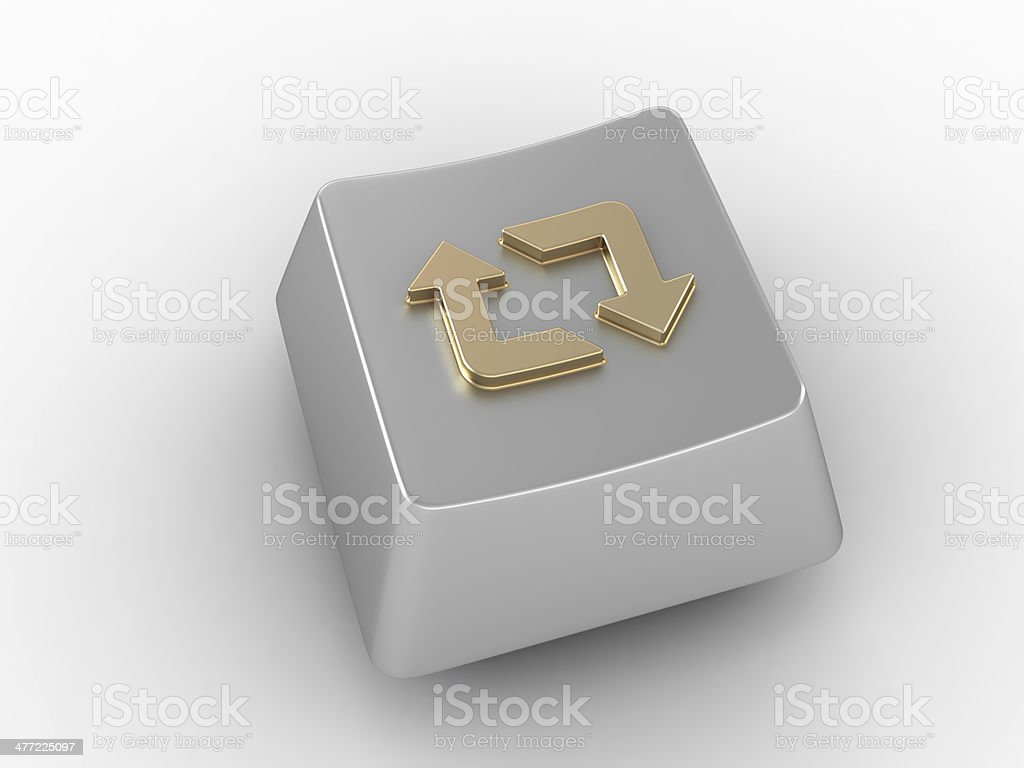 Keyboard key with gold loop arrows sign. stock photo