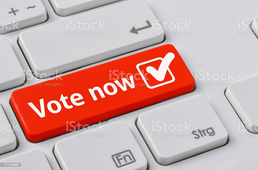 Keyboard with a red button - Vote now stock photo