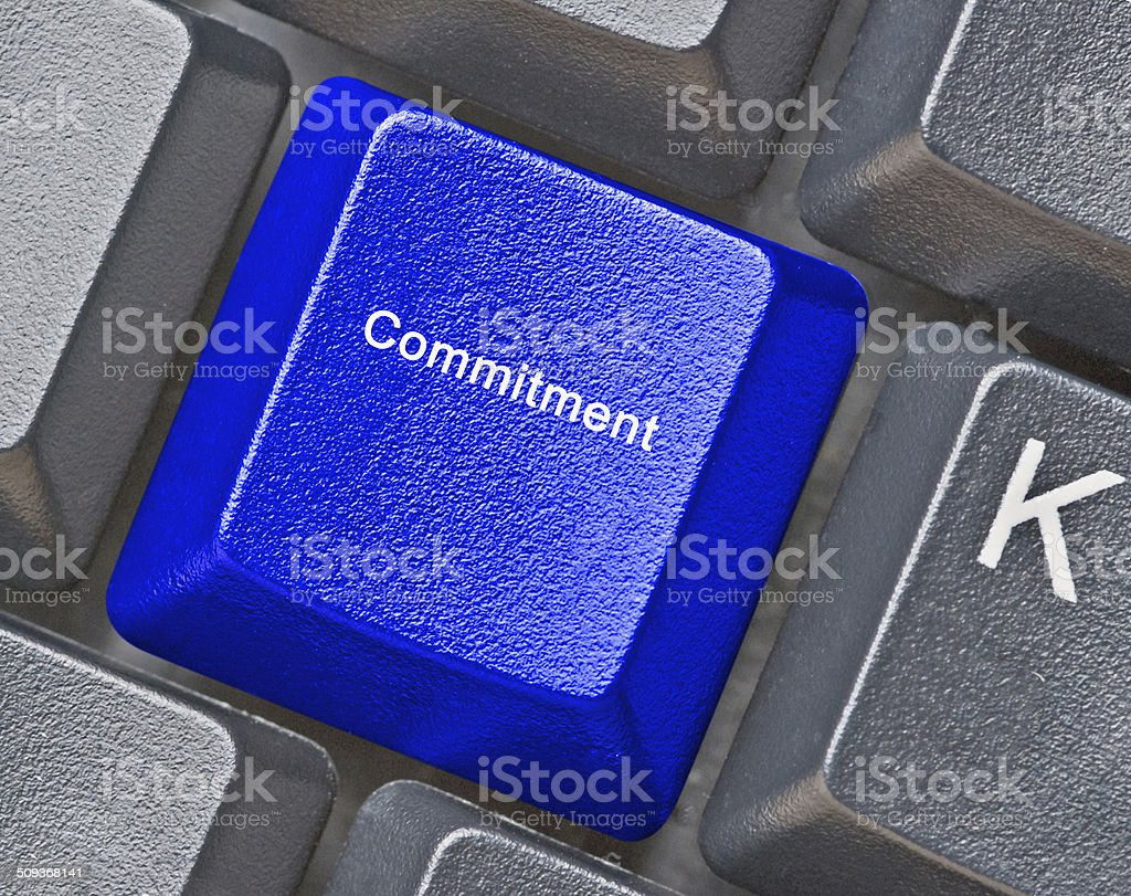 keyboard with key for commitment stock photo