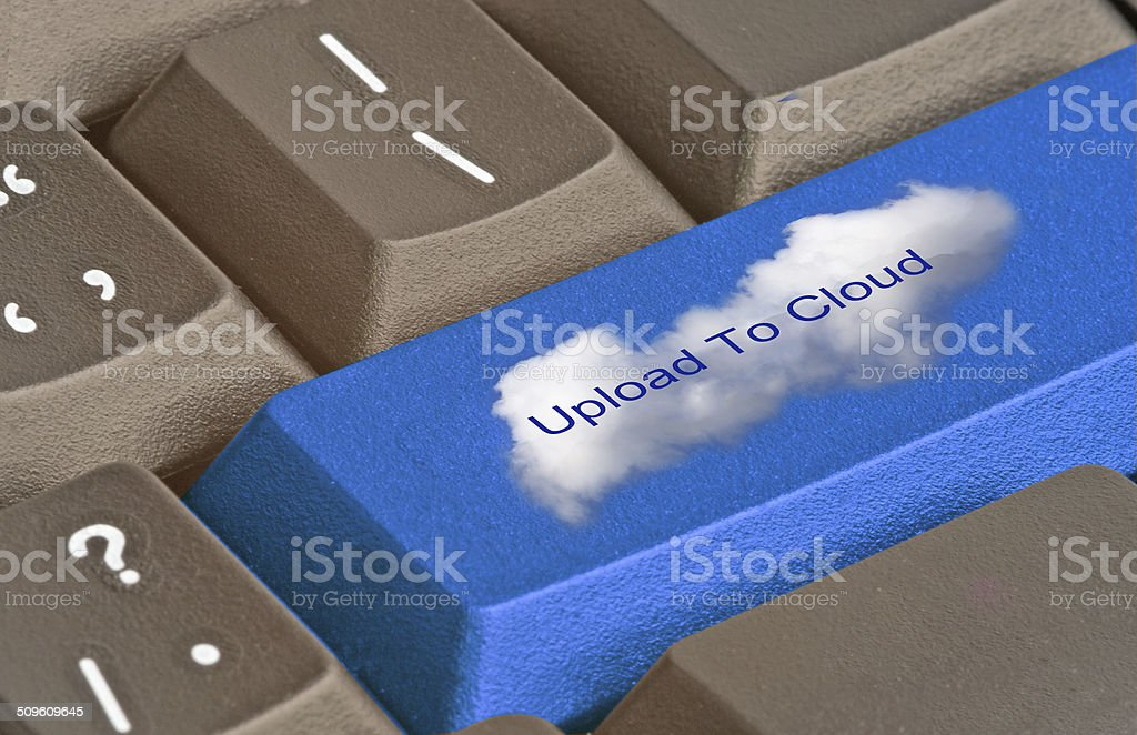 keyboard with key to upload to cloud stock photo