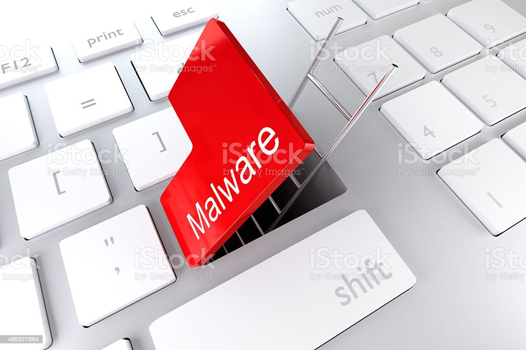 keyboard with red enter key malware stock photo