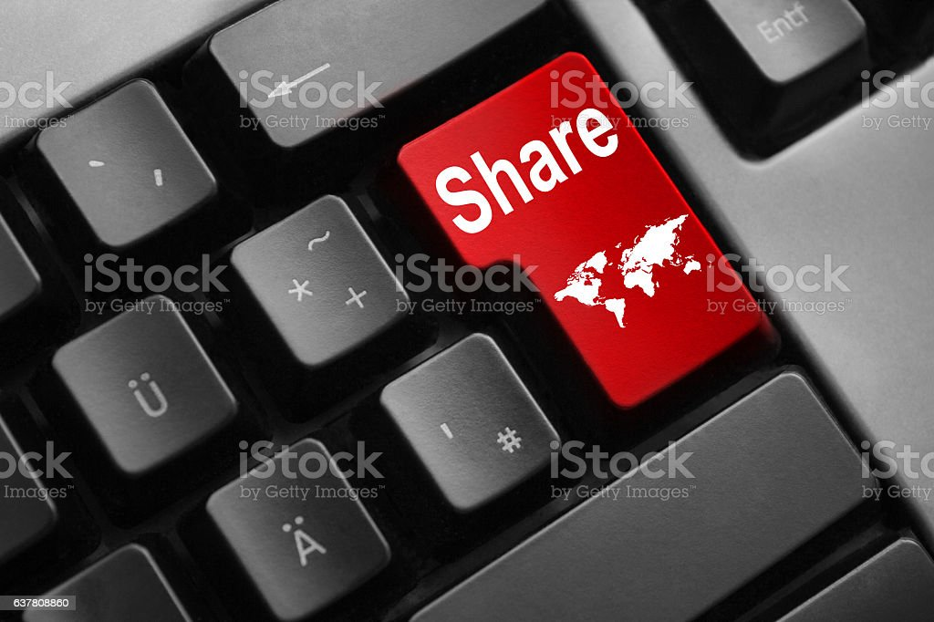 keyboard with red enter key share internet stock photo