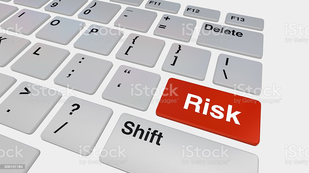 Keyboard with red risk button stock photo