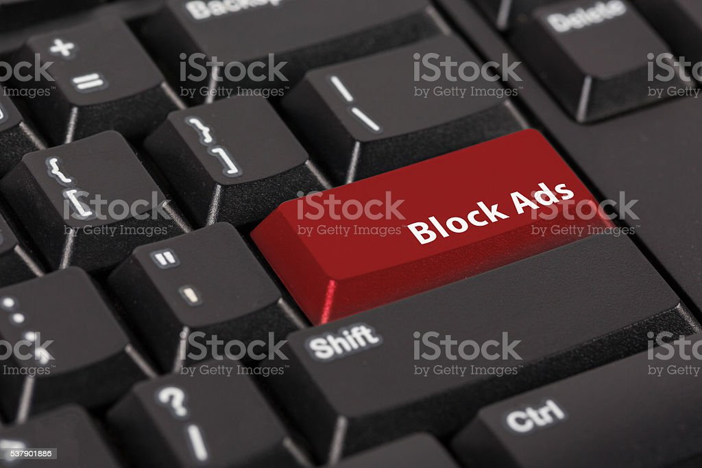 Keyboard with the word Block Ads on red button. stock photo