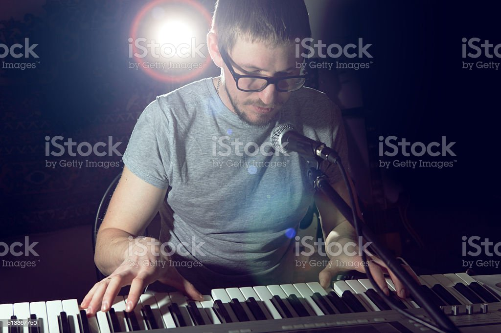 keyboarder is playing and singing. stock photo