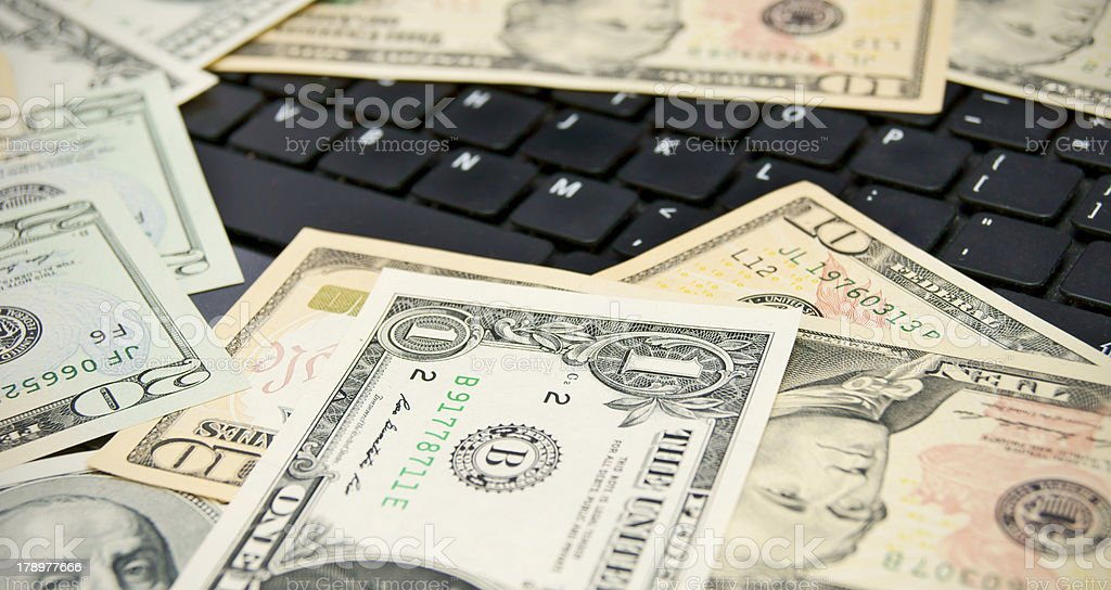 Keyboards and dollars. royalty-free stock photo