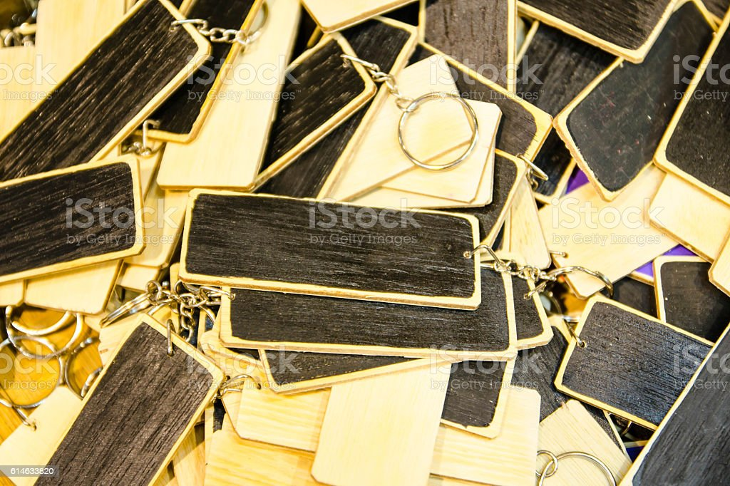 Keychain stack of wood for sale in the market. stock photo