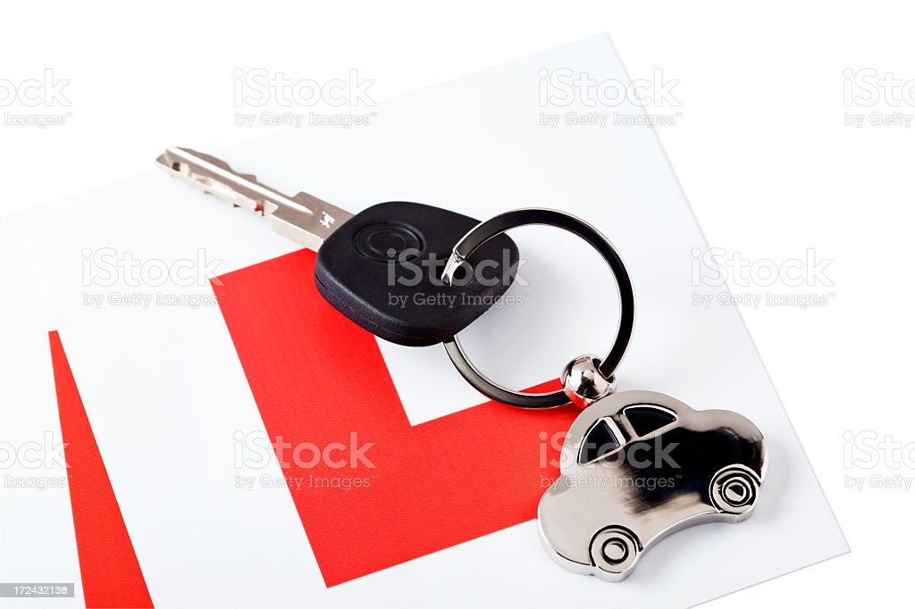 A keychain with a silver car and one key on white background stock photo