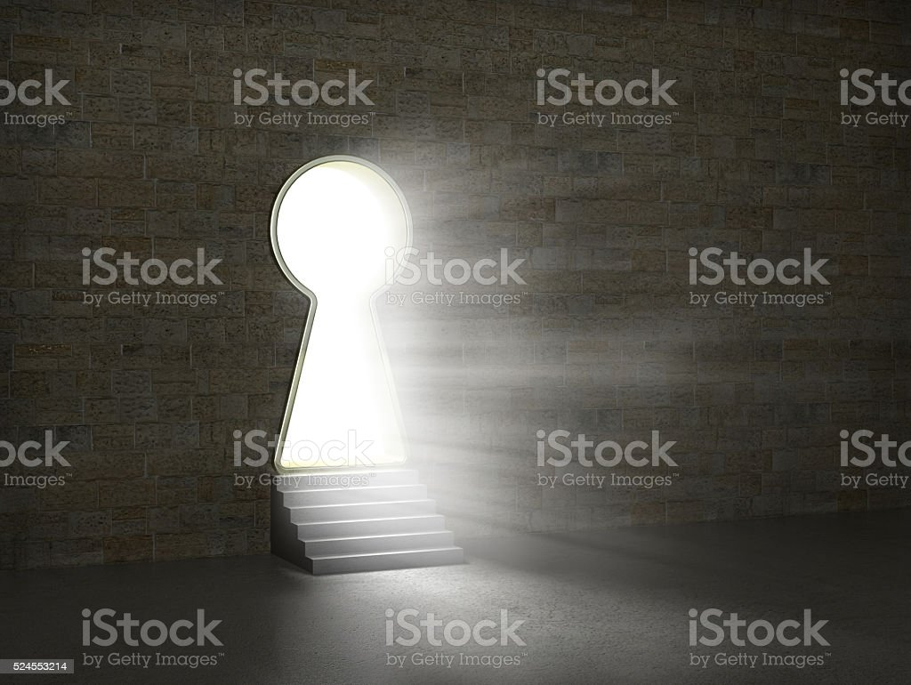 Keyhole in a stone wall. stock photo