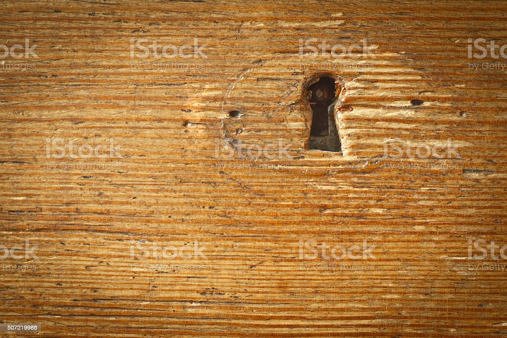 keyhole in wooden wall stock photo