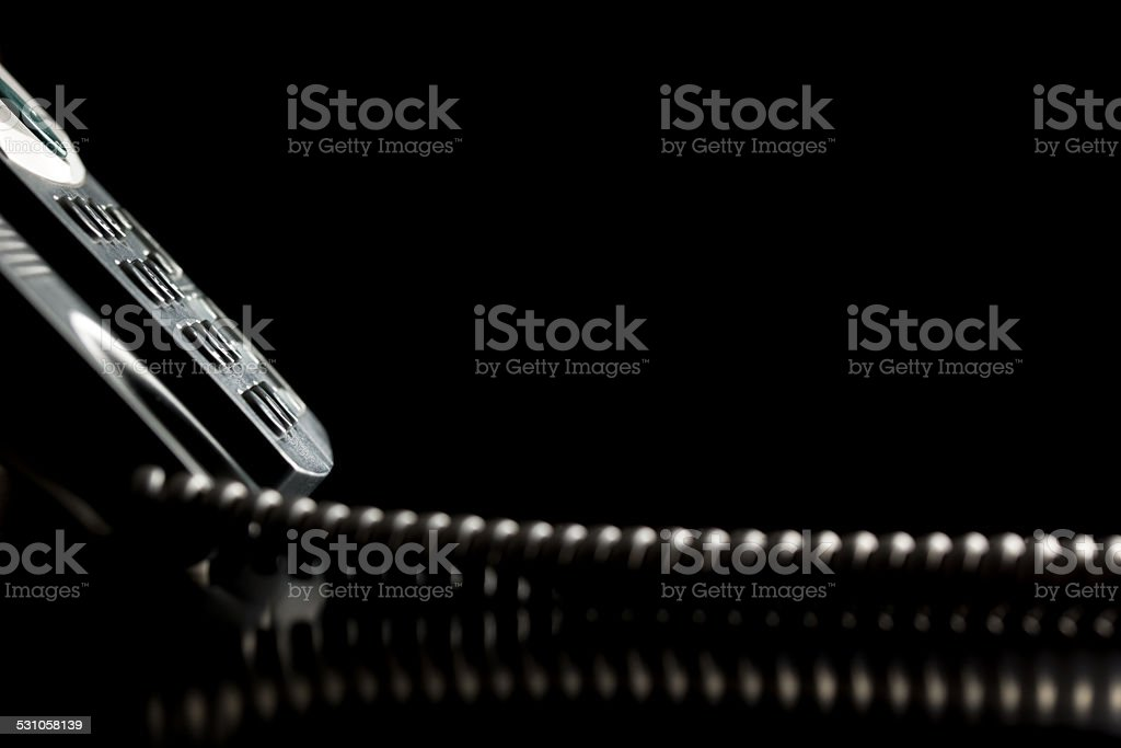 Keypad of a telephone instrument over black background stock photo