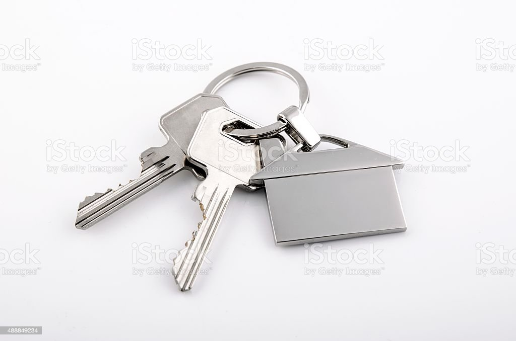 Keys and house chrome pendant with home shape stock photo