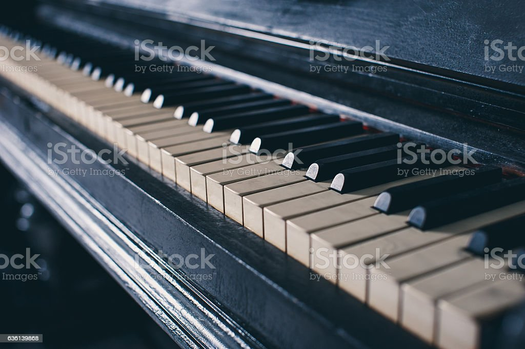 keys classical piano in rays of light stock photo