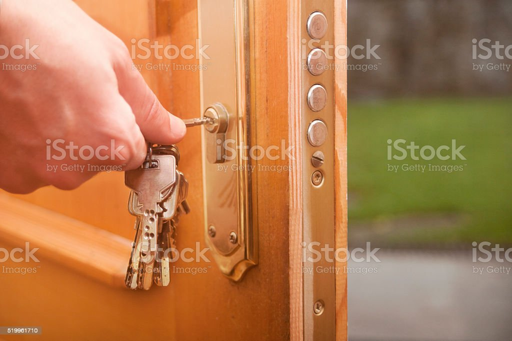 Keys closing the door, garden outside. stock photo