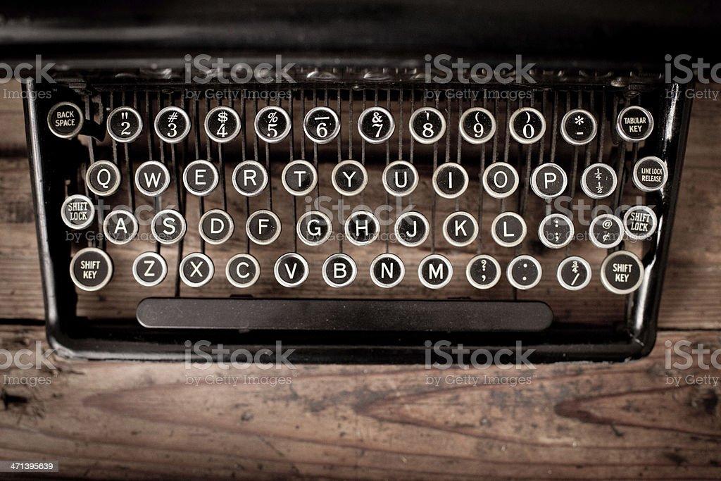 Keys of Vintage, Black, Manual Typewriter on Wood Trunk stock photo