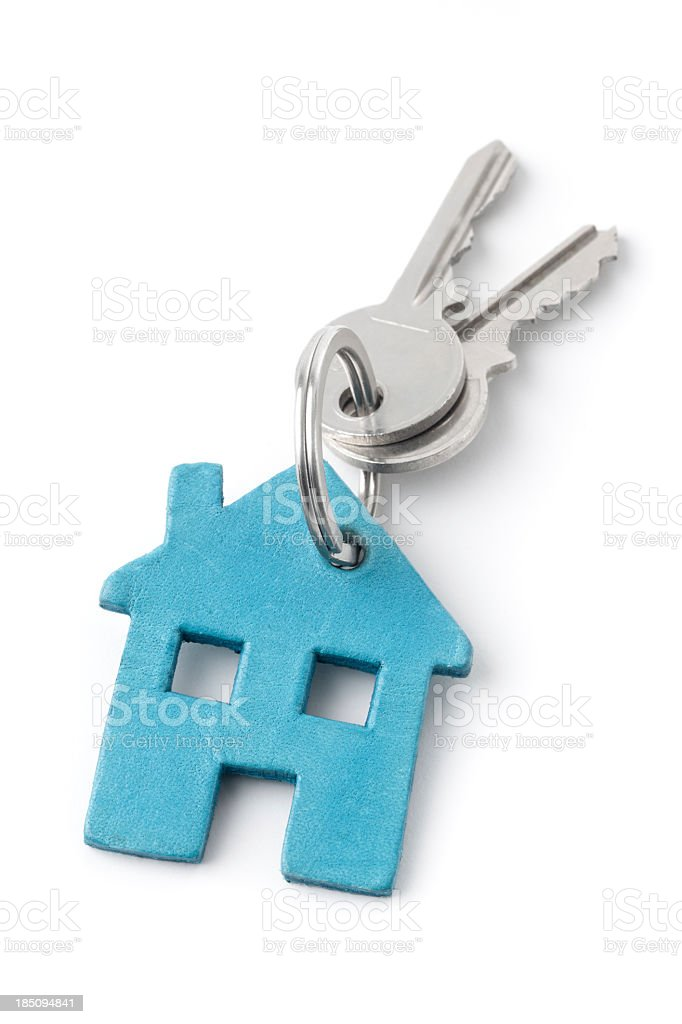Keys on a house keychain against white background stock photo