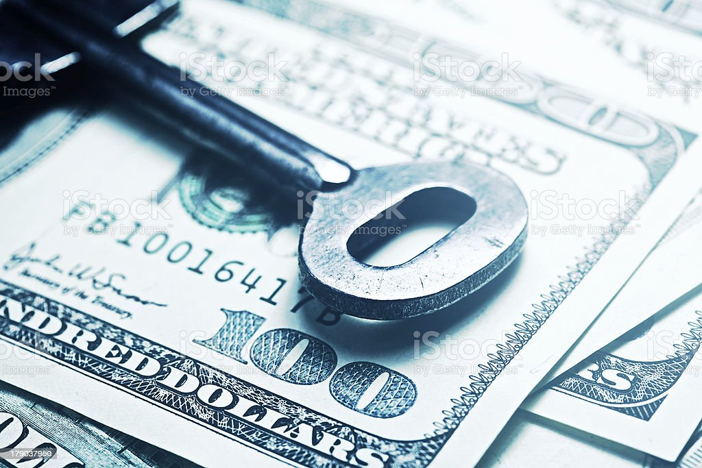 Keys on a one hundred dollar banknote. royalty-free stock photo
