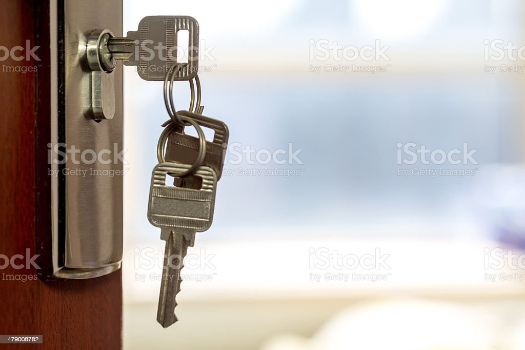 keys on the door stock photo