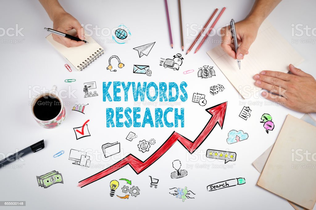 Keywords Research Business Concept. The meeting at the white office table stock photo