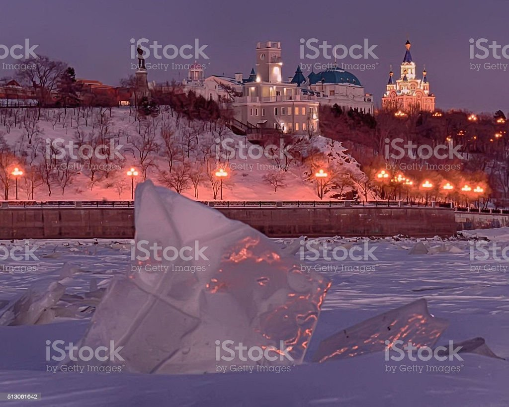 Khabarovsk. Winter evening before Christmas. The view from the Amur river. stock photo