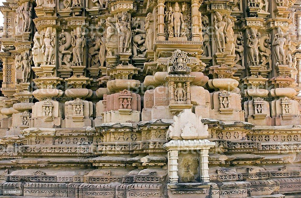 Khajuraho India: Erotic Statues at Hindu Temple Site royalty-free stock photo