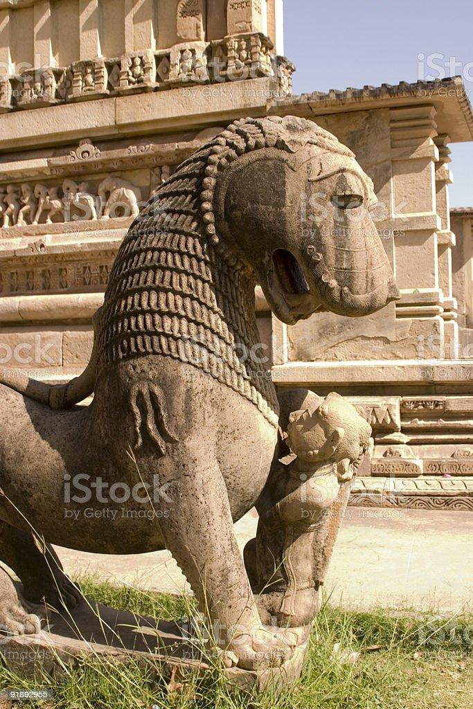 Khajuraho India: Lion Statue at Hindu Temple Site royalty-free stock photo