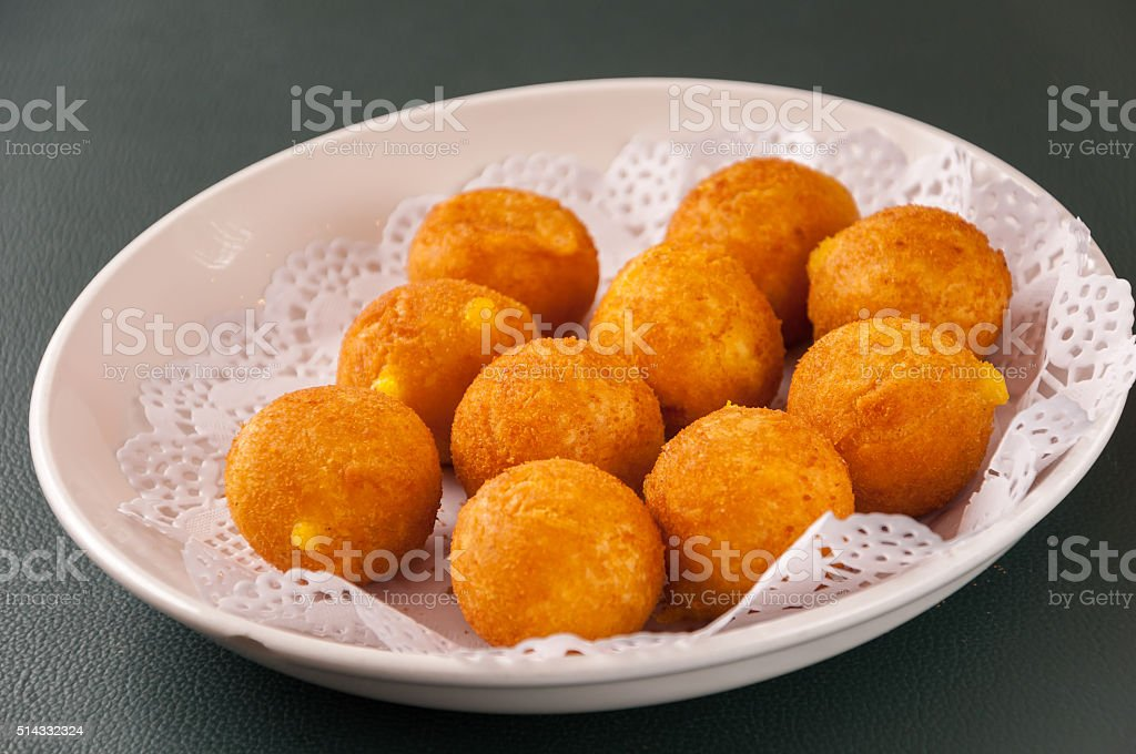 Khanom kai nok krata or deep-fried sweet potato balls stock photo