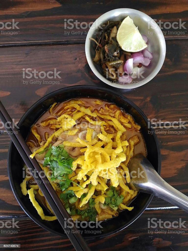 Khao Soi Kai noodle on wooden table stock photo
