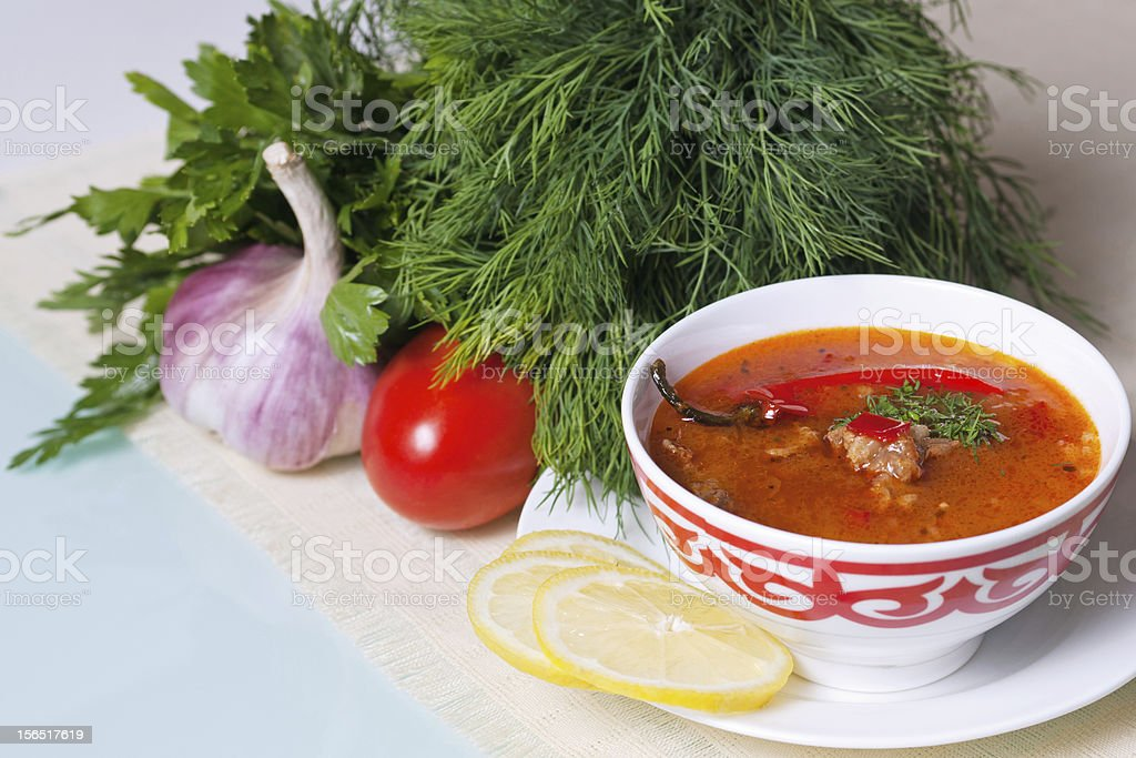 Kharcho soup served with vegetables and green GORIZ royalty-free stock photo