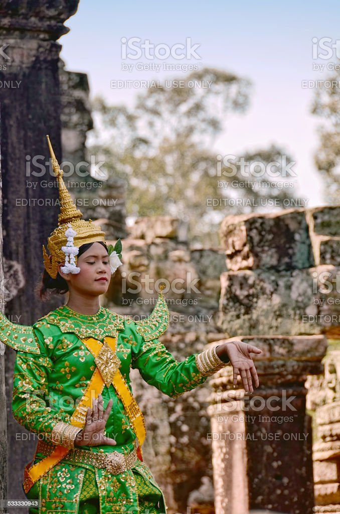 Khmer female dancer performing in traditional Cambodian costume stock photo