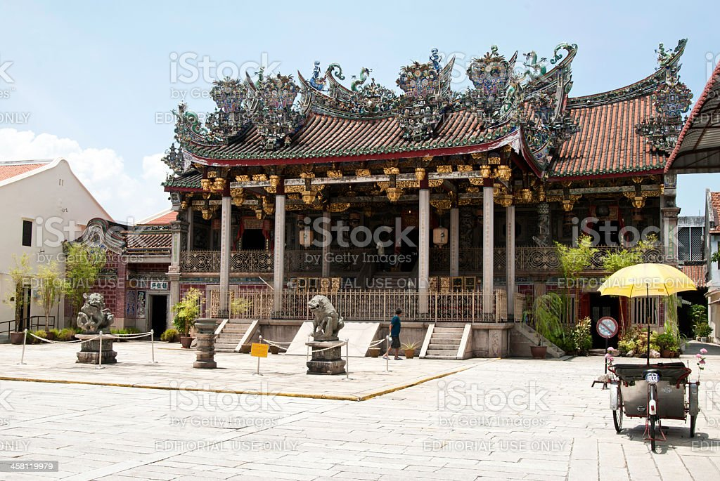Khoo Kongsi Temple with parked Trishaw stock photo
