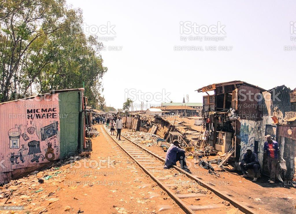 Kibera slum. People and railway to Nairobi stock photo