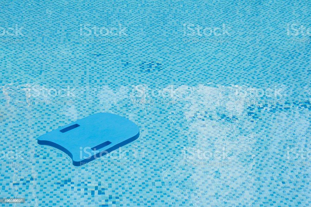 KIck board in swimming pool stock photo