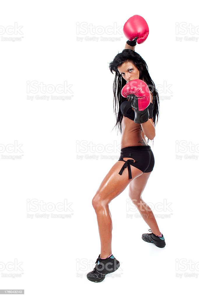 Kick boxing girl with red gloves isolated on the white royalty-free stock photo